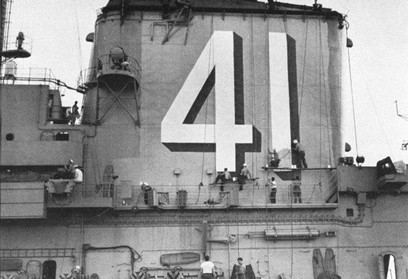 Sailors_painting_pennant_number_on_USS_Midway_(CVA-41)_in_1955